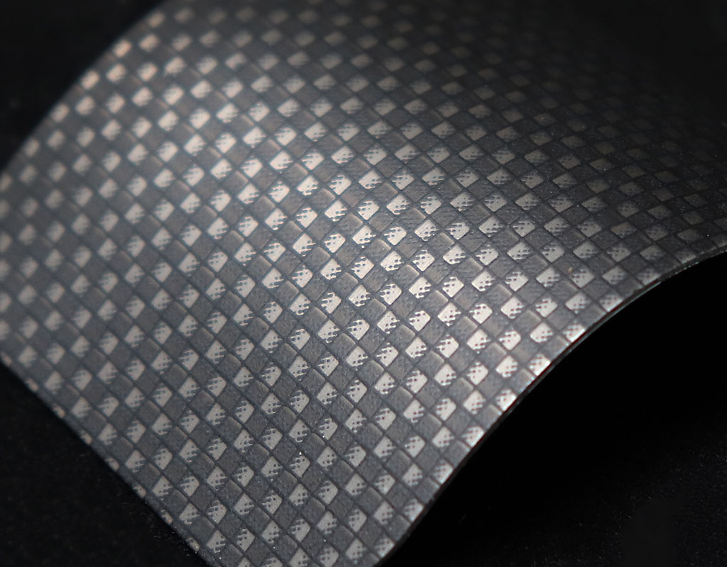 Carbon fiber weave pattern on aluminum surface